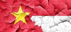 Vietnam flag with Indonesia flag on a grunge cracked wall - stock illustration
