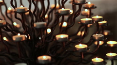 Many burning candles in the cathedral - stock footage