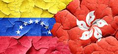 Venezuela flag with Hong Kong flag on a grunge cracked wall - stock illustration