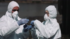Forensic scientist examining sample at river bank - stock footage