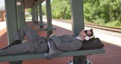 Business Man Resting at Train Station Woke up From Phone Call, 4K Stock Footage