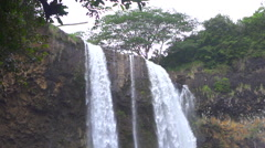 SLOW MOTION CLOSE UP: Beautiful vertical drop of waterfall falling into the lake - stock footage