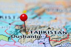 Dushanbe pinned on a map of Tajikistan - stock photo