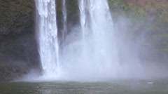 SLOW MOTION CLOSE UP: Whitewater waterfall falling heavily into the lake - stock footage