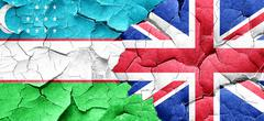 Uzbekistan flag with Great Britain flag on a grunge cracked wall Stock Illustration