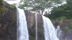 SLOW MOTION CLOSE UP: Amazing vertical drop of waterfall falling into the lake - stock footage