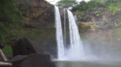 SLOW MOTION: Big majestic waterfall falling down the high rocky wall Stock Footage