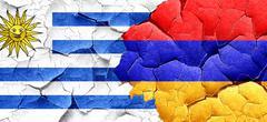 Uruguay flag with Armenia flag on a grunge cracked wall - stock illustration