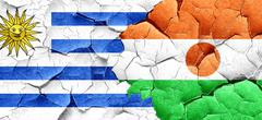 Uruguay flag with Niger flag on a grunge cracked wall - stock illustration