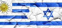 Uruguay flag with Israel flag on a grunge cracked wall Stock Illustration