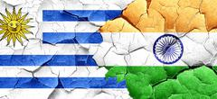 Uruguay flag with India flag on a grunge cracked wall Stock Illustration