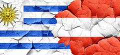 Uruguay flag with Austria flag on a grunge cracked wall Stock Illustration