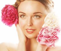 young beauty woman with flower peony pink closeup makeup soft tender gentle look - stock photo