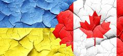 Ukraine flag with Canada flag on a grunge cracked wall Piirros