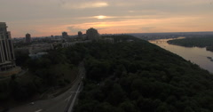 Evening city park and skyline aerial view Stock Footage