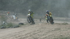 Motocross Competition on the Rough Terrain. Racers Are Riding at High Speed. Stock Footage