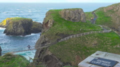 Carrick-a-Rede Rope Bridge, Ballintoy, Northern Ireland, UK Stock Footage