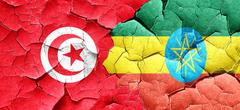 Tunesia flag with Ethiopia flag on a grunge cracked wall Stock Illustration