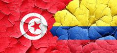 Tunesia flag with Colombia flag on a grunge cracked wall - stock illustration