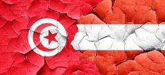 Tunesia flag with Austria flag on a grunge cracked wall Stock Illustration