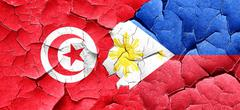 Tunesia flag with Philippines flag on a grunge cracked wall Stock Illustration