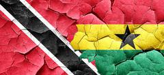 Trinidad and tobago flag with Ghana flag on a grunge cracked wal - stock illustration