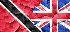Trinidad and tobago flag with Great Britain flag on a grunge cra - stock illustration