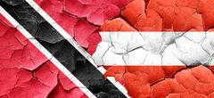 Trinidad and tobago flag with Austria flag on a grunge cracked w Stock Illustration