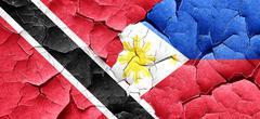 Trinidad and tobago flag with Philippines flag on a grunge crack Stock Illustration