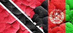 Trinidad and tobago flag with afghanistan flag on a grunge crack Stock Illustration
