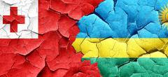 Tonga flag with rwanda flag on a grunge cracked wall - stock illustration