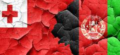 Tonga flag with afghanistan flag on a grunge cracked wall Stock Illustration