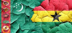 Turkmenistan flag with Ghana flag on a grunge cracked wall Stock Illustration