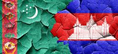Turkmenistan flag with Cambodia flag on a grunge cracked wall Stock Illustration