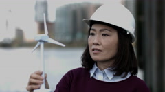 Engineer working on a Wind Turbine project at river bank Stock Footage