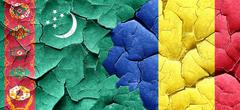 Turkmenistan flag with Romania flag on a grunge cracked wall Stock Illustration