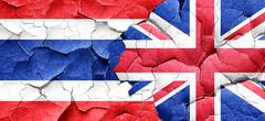 Thailand flag with Great Britain flag on a grunge cracked wall Stock Illustration