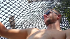 Vacation and Travel - Tourist Man in Hammock on Beach. Slow Motion. - stock footage