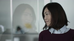 Portrait of Japanese business woman in office Stock Footage