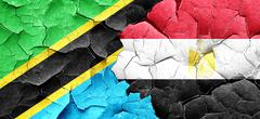 Tanzanian flag with egypt flag on a grunge cracked wall Piirros