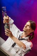Bartender pouring liquor into glass. - stock photo
