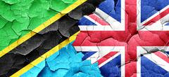 Tanzanian flag with Great Britain flag on a grunge cracked wall Stock Illustration