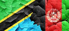 Tanzanian flag with afghanistan flag on a grunge cracked wall Stock Illustration