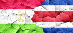 Tajikistan flag with Costa Rica flag on a grunge cracked wall Stock Illustration