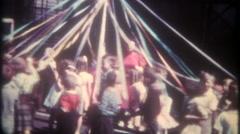 School children dance around the May Pole -3375 vintage film home movie Stock Footage