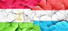 Tajikistan flag with Luxembourg flag on a grunge cracked wall Stock Illustration