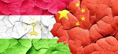 Tajikistan flag with China flag on a grunge cracked wall Stock Illustration