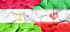 Tajikistan flag with Iran flag on a grunge cracked wall - stock illustration