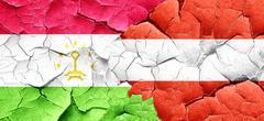 Tajikistan flag with Austria flag on a grunge cracked wall Stock Illustration