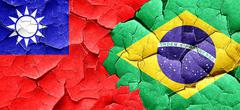 Taiwan flag with Brazil flag on a grunge cracked wall Stock Illustration